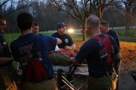 Lt. Mike Goyette, Jonathon McKee, Grant Vaughan, Peter Nash, and Matthem Benoliel practicing their training during Training/House Burn Nov 12, 2006 Transco Road