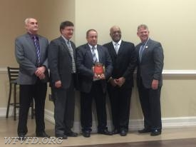 Deputy Chief Mark Miller receives the Officer of the Year Award.
