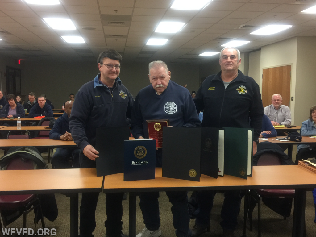 Chief Saunders (center) in 2017 being honored for his many years of service with WFVFD.